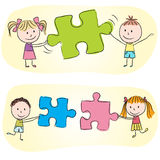 Kids playing with puzzle Royalty Free Stock Image