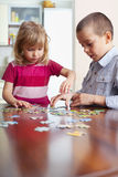 Kids, playing puzzles Stock Image