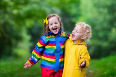 Kids playing in the rain Stock Photography