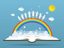 Kids playing with the rainbow on book Royalty Free Stock Photo