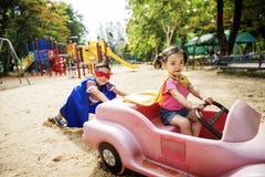 Kids Playing Riding Cart Outdoors Fun Nature Concept Stock Image