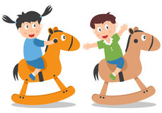 Kids Playing with Rocking Horse Stock Photo