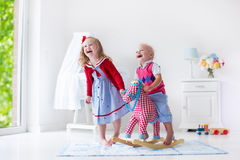 Kids playing with rocking horse Stock Photography