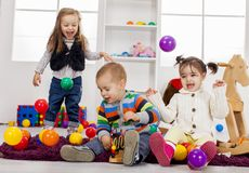 Kids playing in the room Royalty Free Stock Image