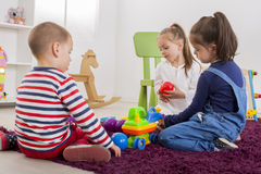 Kids playing in room Royalty Free Stock Photos