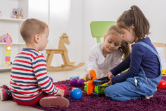 Kids playing in room Royalty Free Stock Image