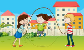 Kids playing rope Stock Images