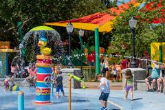 Kids playing in Rubber Duckie Water Works water attraction at Seaworld in International Drive area  2. Orlando, Florida. April 20, 2019.  Kids playing in Rubber stock image