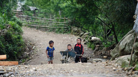 Children playing in Sa Pa valley in Vietnam. Children playing on the rural road in Sa Pa valey in Vietnam royalty free stock image