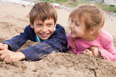 Kids playing in sand. Children having fun playing in sand Stock Image
