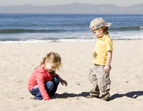 Kids are playing with a sand. On beach Stock Photography