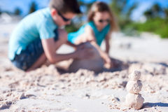 Kids playing with sand Stock Image