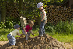 Kids playing in a sandheap Royalty Free Stock Images