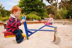 Kids playing in sandpit stock photo