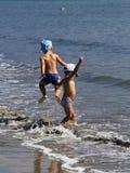 Kids playing in the sea. Kids are enjoying their morning at seaside royalty free stock photo