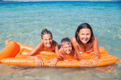 Kids playing in sea. Stock Photos