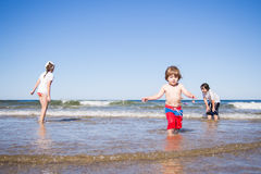 Kids playing in the sea Royalty Free Stock Images