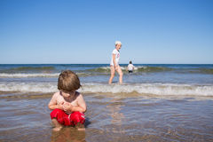 Kids playing in the sea Stock Image