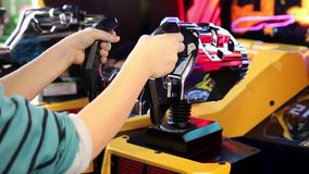 Kids are playing in SEGA Transformers Video Arcade Game. MOSCOW, RUSSIA - APRIL 16, 2015: Kids are playing in SEGA Transformers Video Arcade Game in Game center stock video