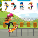 Kids playing skateboards in park Royalty Free Stock Photos