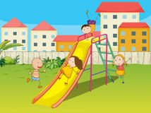 Kids playing on a slide Stock Image
