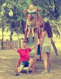 Kids playing on sliding toy Royalty Free Stock Photos