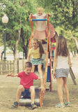 Kids playing on sliding toy Royalty Free Stock Images