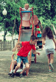 Kids playing on sliding toy Stock Photo