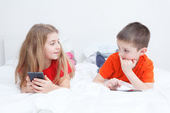 Kids playing with smartphone Stock Photo