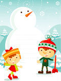 Kids playing with snow Royalty Free Stock Image