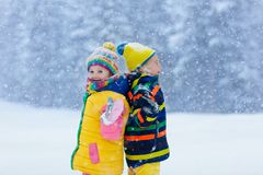 Kids playing in snow. Children play in winter. royalty free stock photography