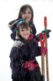 Kids Playing in Snow with Snowflakes Falling Stock Photos