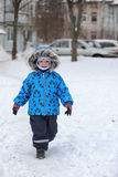Kids playing with snow in winter on backyard Royalty Free Stock Photos