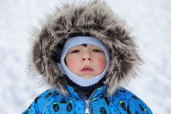 Kids playing with snow in winter on backyard. In city Stock Photography