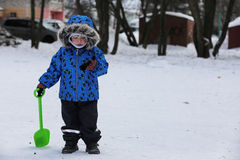 Kids playing with snow in winter on backyard. In city Stock Photo