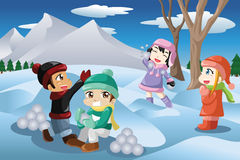 Kids playing snowballs Royalty Free Stock Images