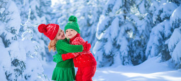 Kids playing in snowy winter forest Royalty Free Stock Photos