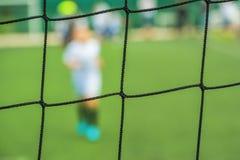 Kids playing soccer Royalty Free Stock Image