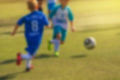 Kids playing soccer Stock Image