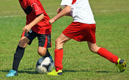 Kids are playing soccer Stock Photos