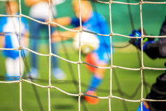 Kids playing soccer, penalty kick Royalty Free Stock Images
