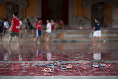 Kids playing soccer. On their bare feet in a temple Royalty Free Stock Photography