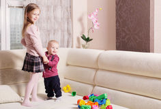 Kids playing on sofa Royalty Free Stock Image