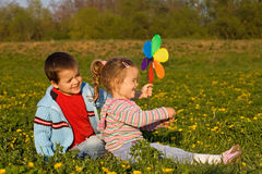 Kids playing on the spring flower field. Kids playing on the spring meadow full of flowers royalty free stock photos