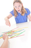 Kids playing stick game Royalty Free Stock Photos