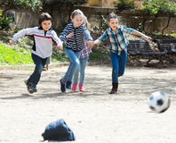 Kids playing street football Royalty Free Stock Photos