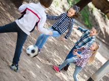 Kids playing street football Stock Photos