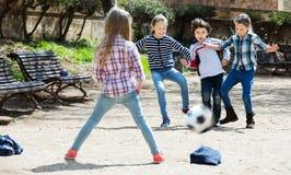 Kids playing street football stock photo