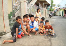 Kids playing on street of Manado Stock Photography