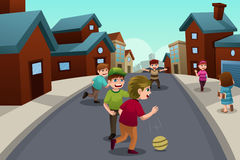 Kids playing in the street of a suburban neighborhood. A vector illustration of happy kids playing in the street of a suburban neighborhood royalty free illustration